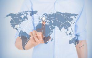 Man touching on world map with futuristic communication interface.